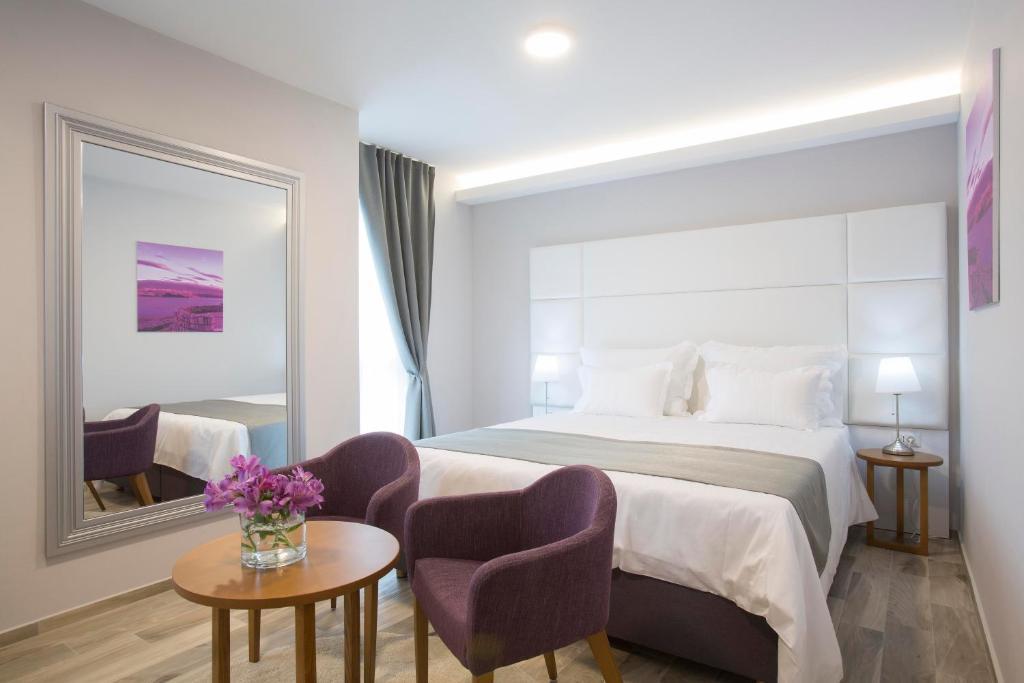 Letto o letti in una camera di Boutique Hotel Intermezzo - Pag centre