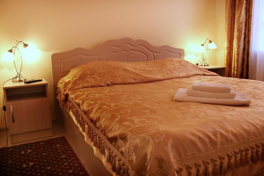 Кровать или кровати в номере Отель Прометей