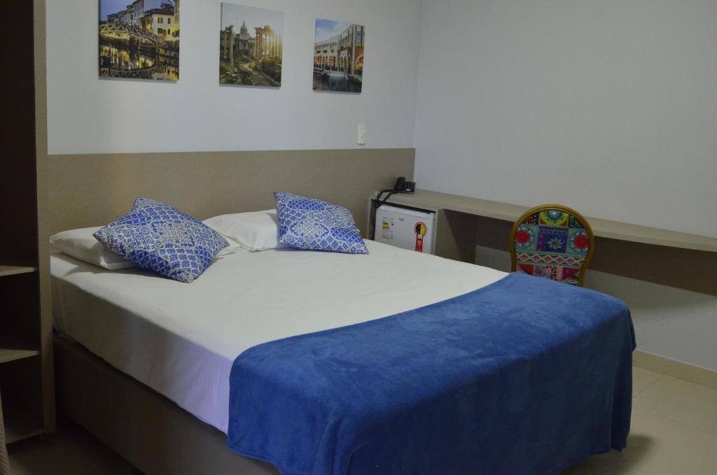 Cama ou camas em um quarto em Atlas Hotel