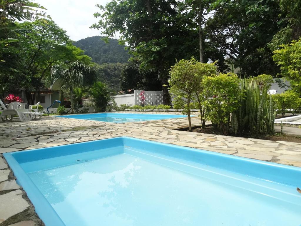 The swimming pool at or near Hotel Portal da Praia