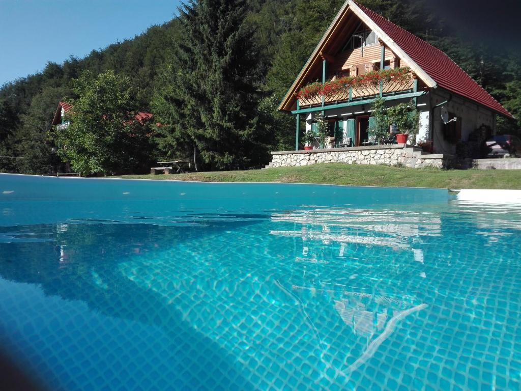 The swimming pool at or near Pensiunea Ioana