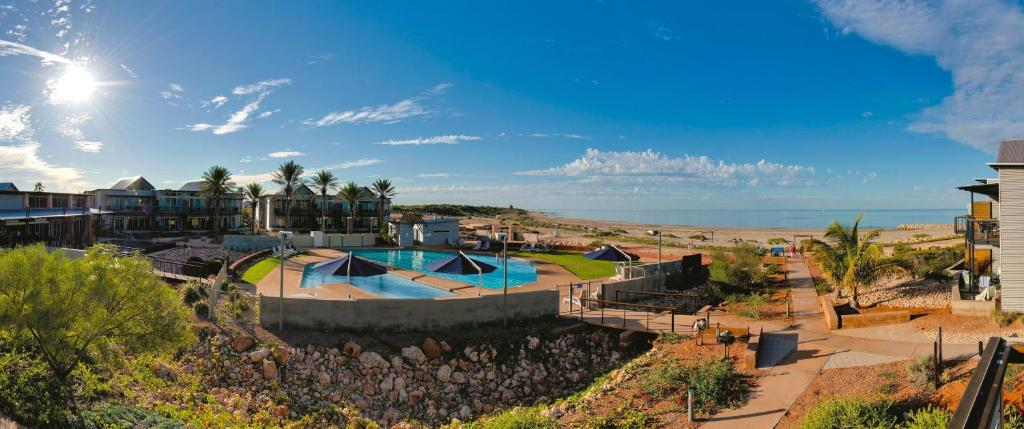 A view of the pool at Mantarays Ningaloo Beach Resort or nearby
