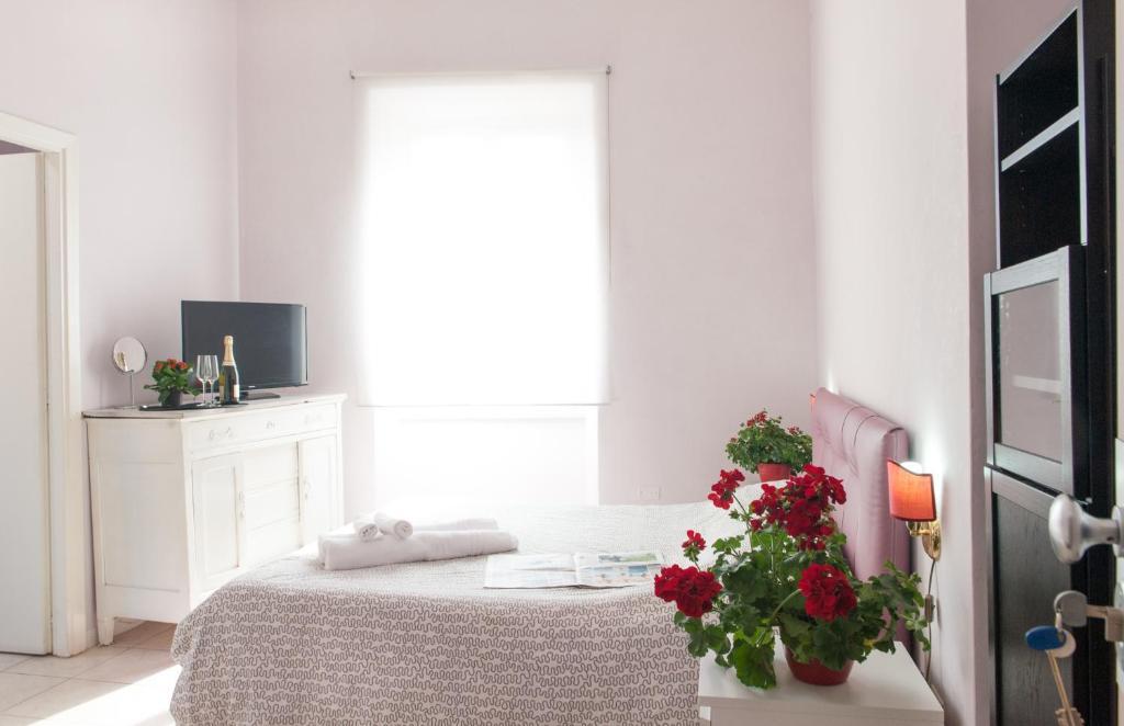 Un ou plusieurs lits dans un hébergement de l'établissement Pigneto Rooms
