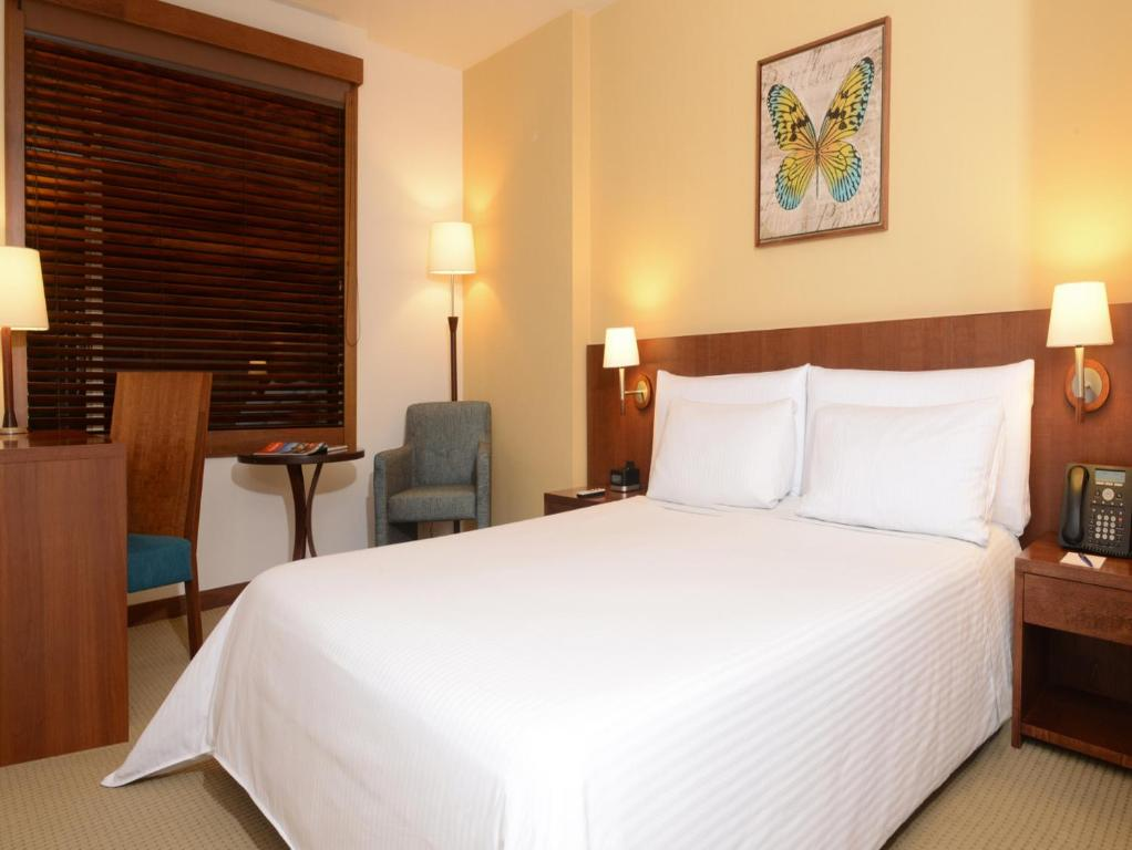A bed or beds in a room at Hotel Habitel Select