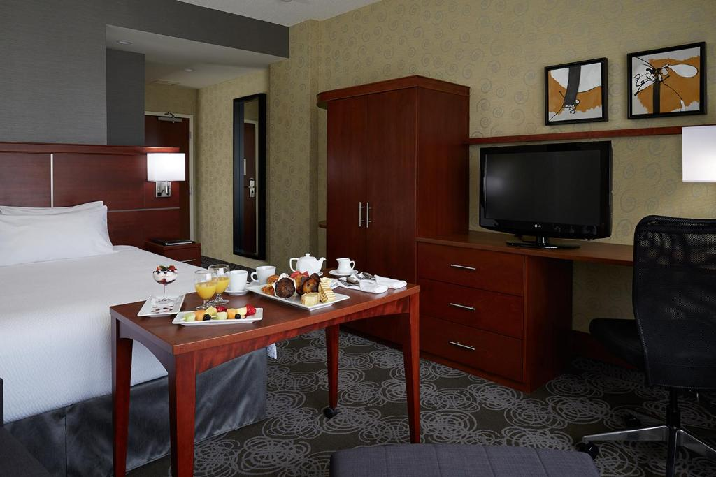 A television and/or entertainment center at Courtyard by Marriott Montreal Airport