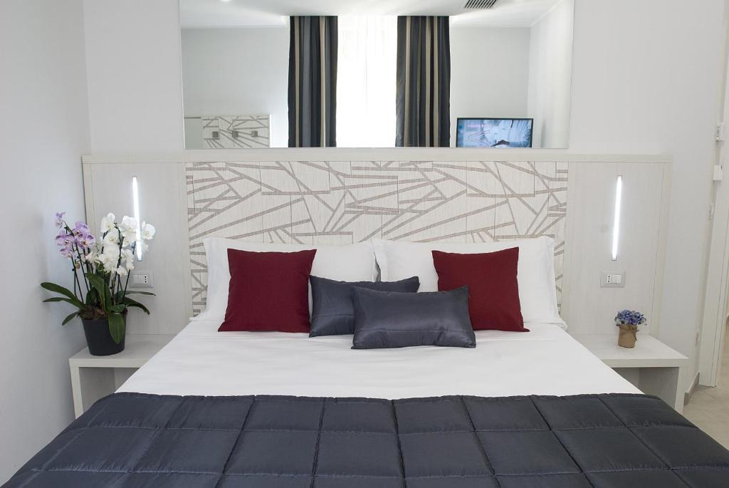 A bed or beds in a room at Merulana Holidays