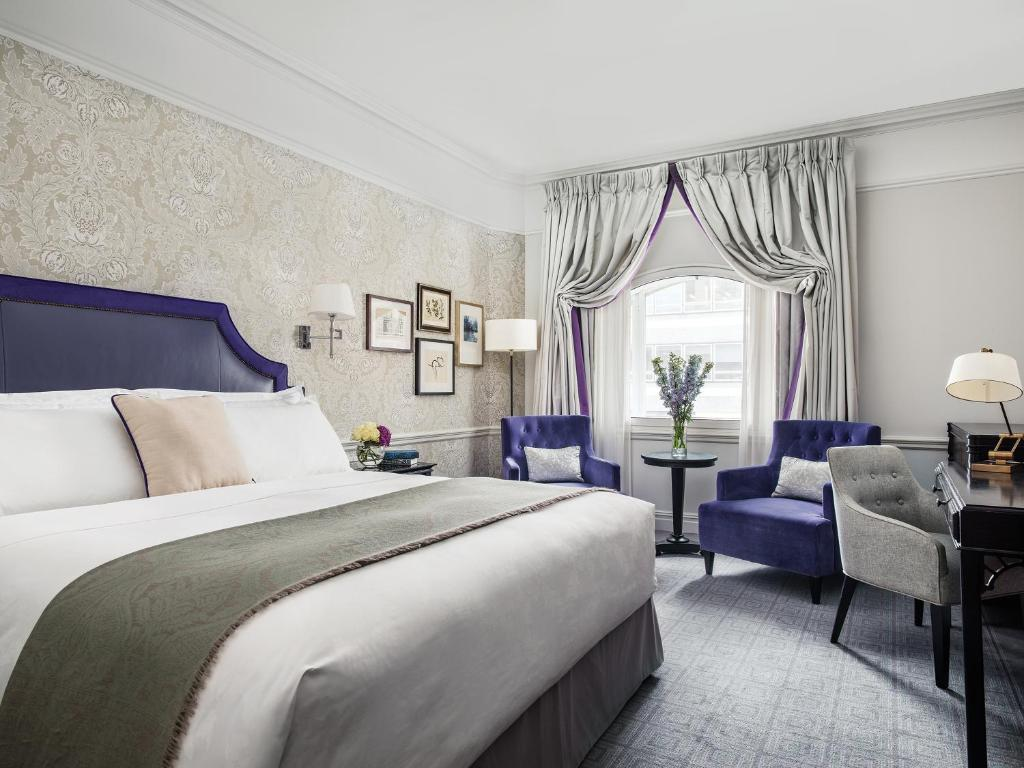 A bed or beds in a room at The Langham London