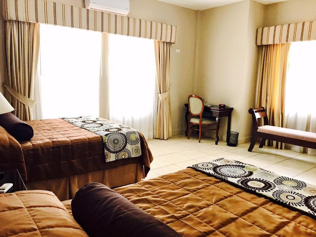 Cama o camas de una habitación en Comayagua Golf Club