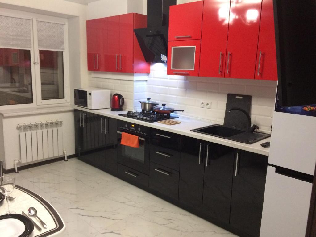 Кухня или мини-кухня в Апартаменты на Всполье 19