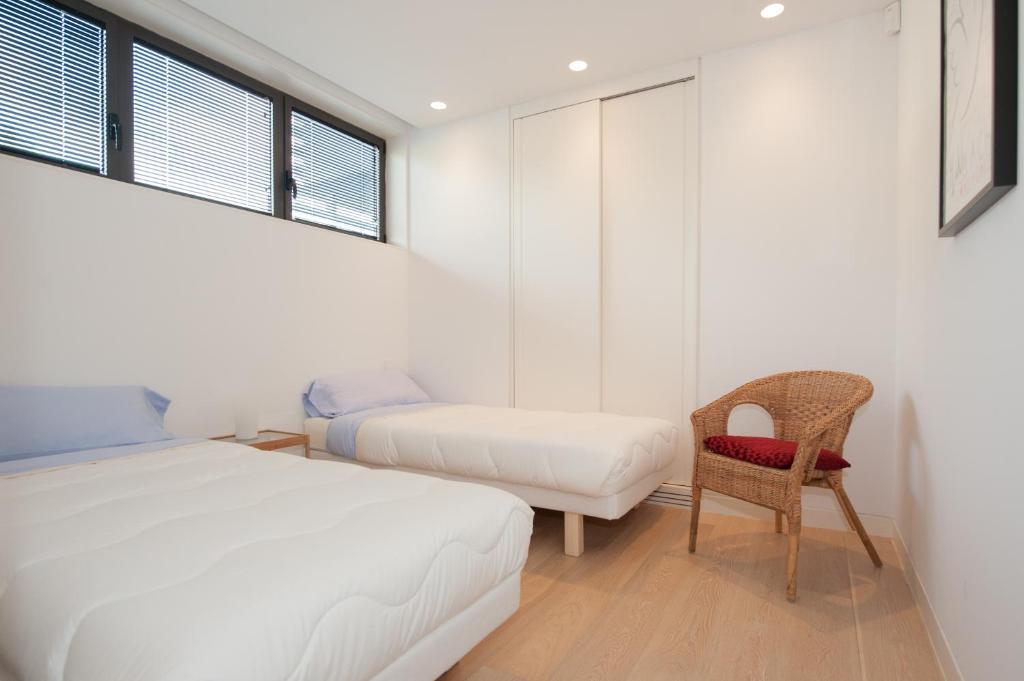 A bed or beds in a room at Holiday Rentals at PGA Catalunya