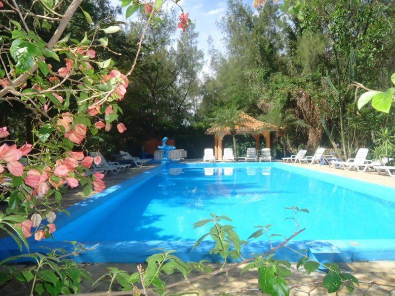 The swimming pool at or close to Pousada Fazendinha Tatuira