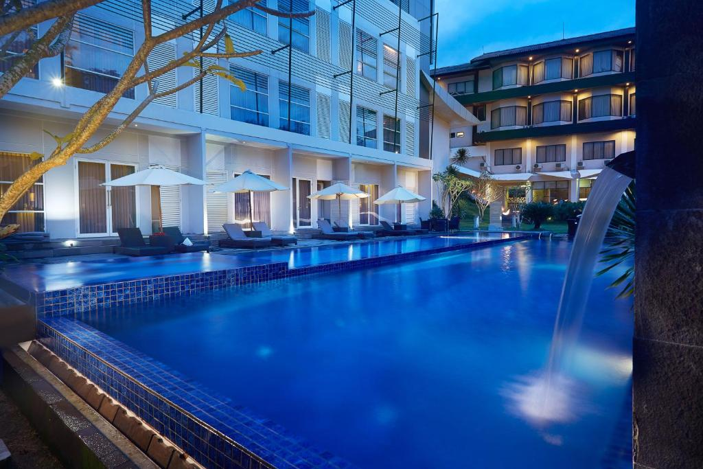 The swimming pool at or near Grand Kecubung Hotel