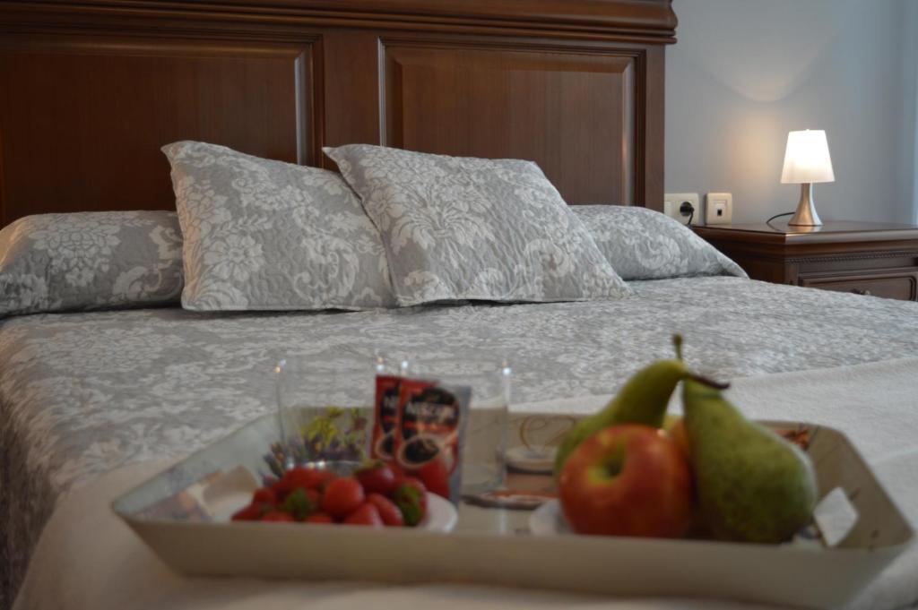 Cama o camas de una habitación en Casa Apartamento Rural La Sinagoga de Trujillo