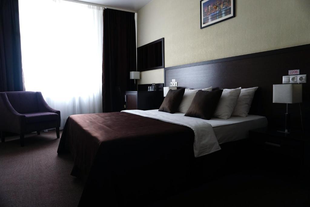 Кровать или кровати в номере Отель Мистер Жулебин