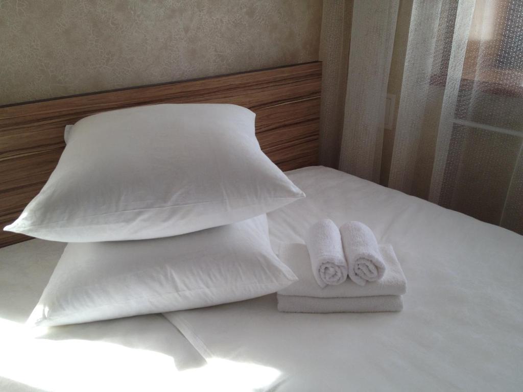 Кровать или кровати в номере Апартаменты ЦУМ
