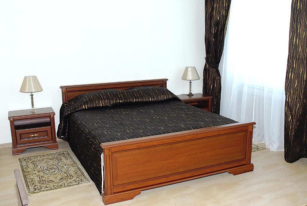 Кровать или кровати в номере Hotel Arian