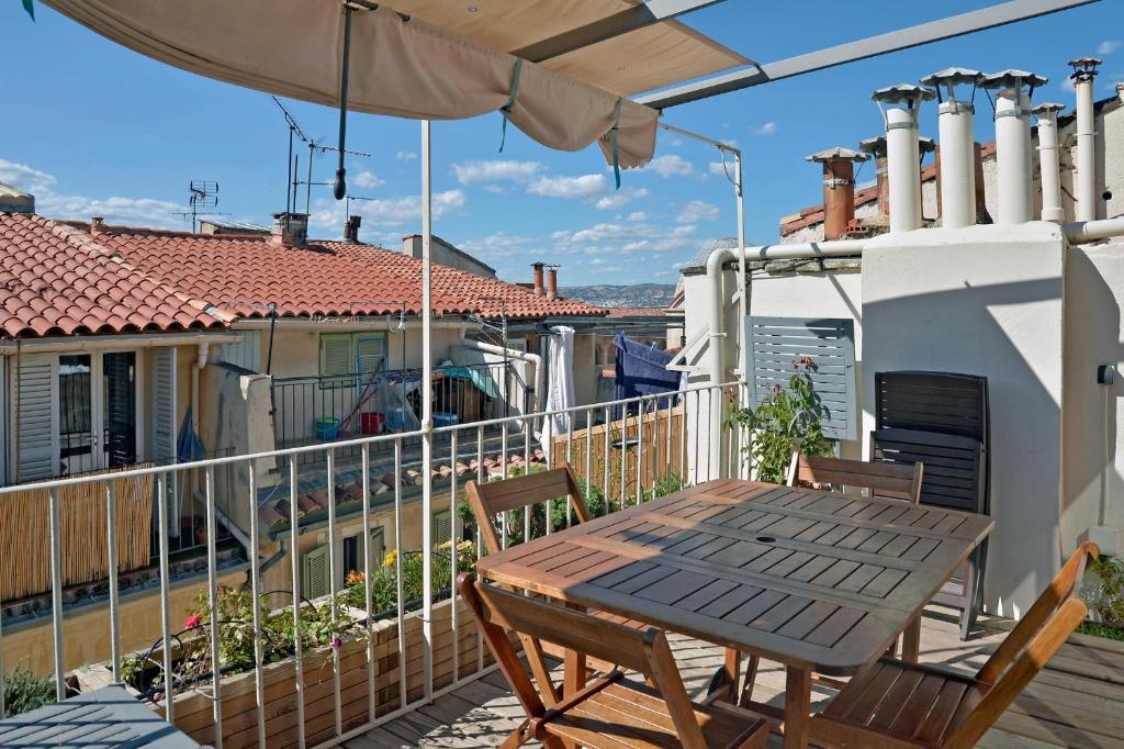 A balcony or terrace at Duplex Panier
