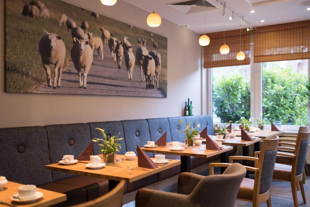 Ein Restaurant oder anderes Speiselokal in der Unterkunft BE BIO Hotel be active