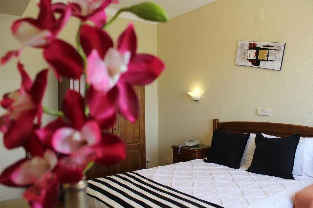 Uma cama ou camas num quarto em A Muralha