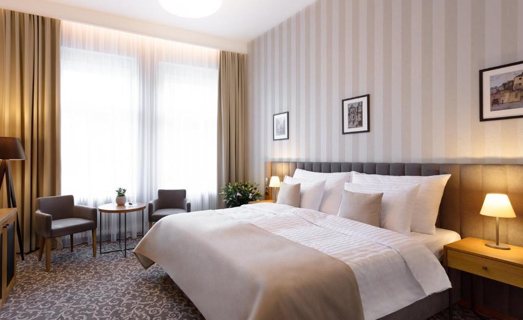 Кровать или кровати в номере Hotel Schwaiger