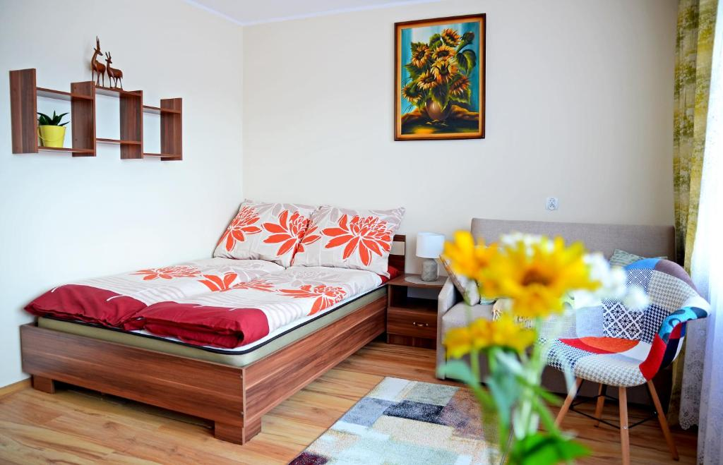Łóżko lub łóżka w pokoju w obiekcie Apartament KARINA