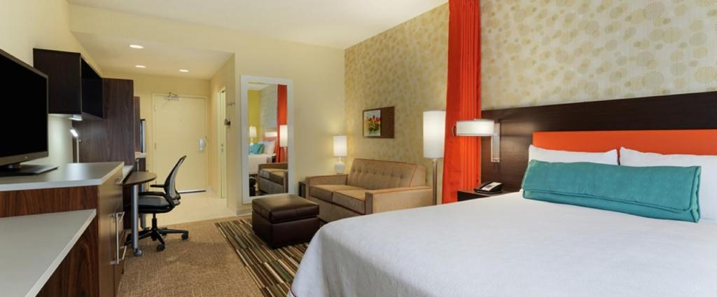 A bed or beds in a room at Home2 Suites by Hilton Springfield North