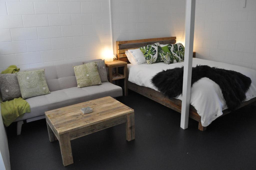 A bed or beds in a room at The Jungle Stays