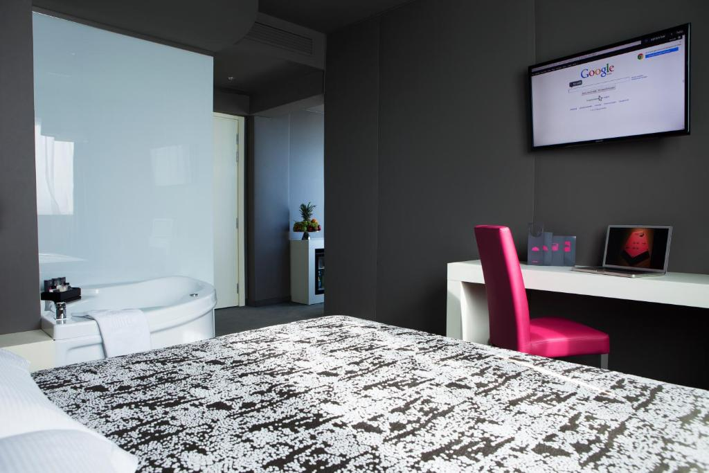 A bed or beds in a room at Smart Hotel