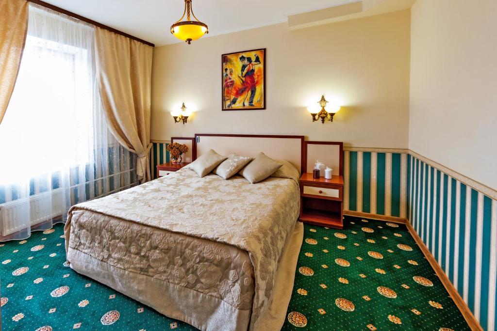 Кровать или кровати в номере Гостиница Электрон