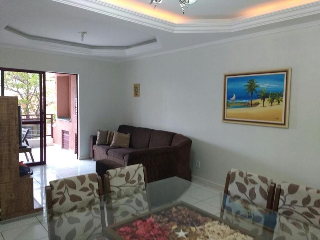 A seating area at Apartamento 3 quartos