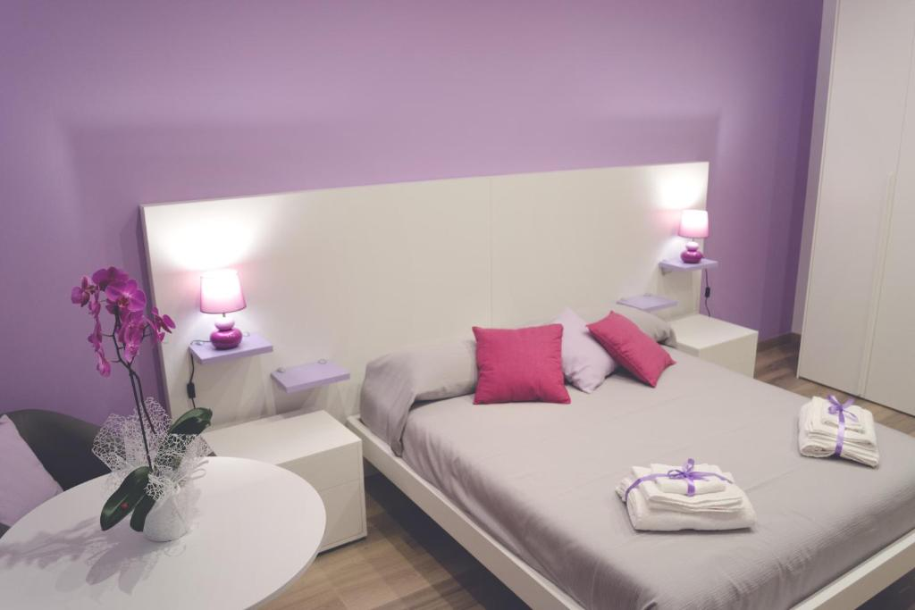 A bed or beds in a room at Mare di Luci