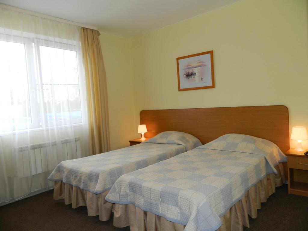 Кровать или кровати в номере Отель Таймаут