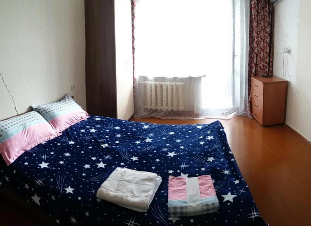 Кровать или кровати в номере Амурский бульвар 66 (2) Вокзал