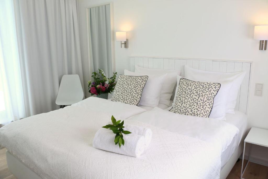 Ein Bett oder Betten in einem Zimmer der Unterkunft Berdorfer Eck