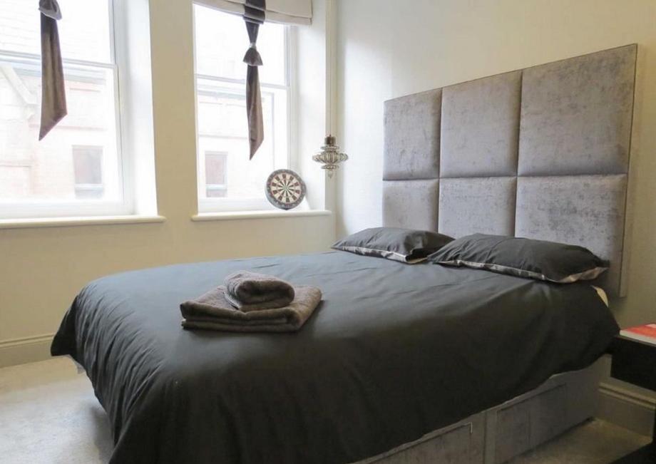 Łóżko lub łóżka w pokoju w obiekcie Trip & Hostel
