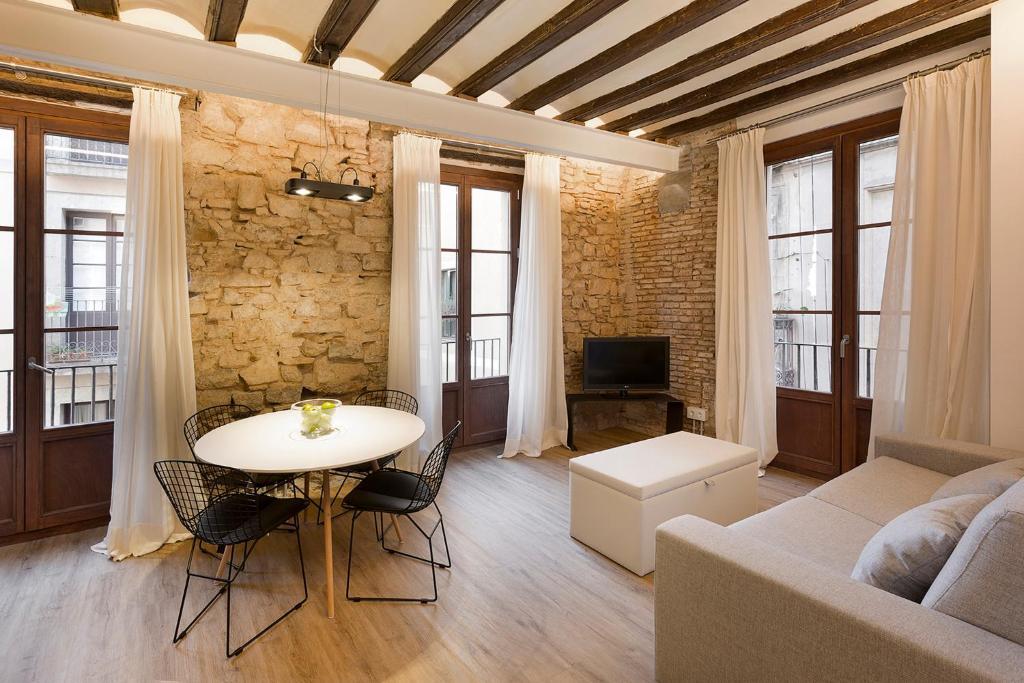 Area soggiorno di Decô Apartments Barcelona-Born Apt.