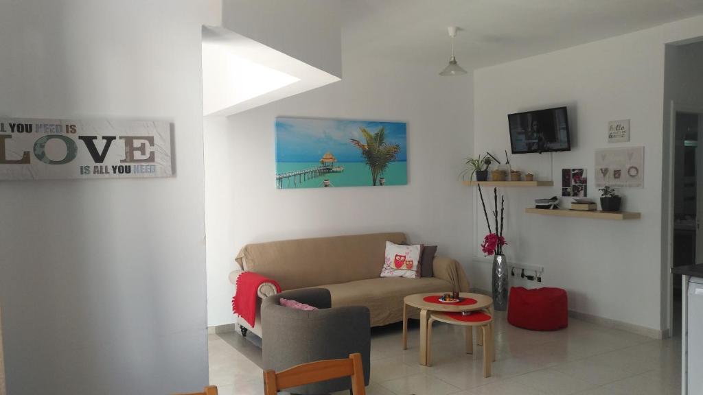 Coin salon dans l'établissement Apartamento Anaca