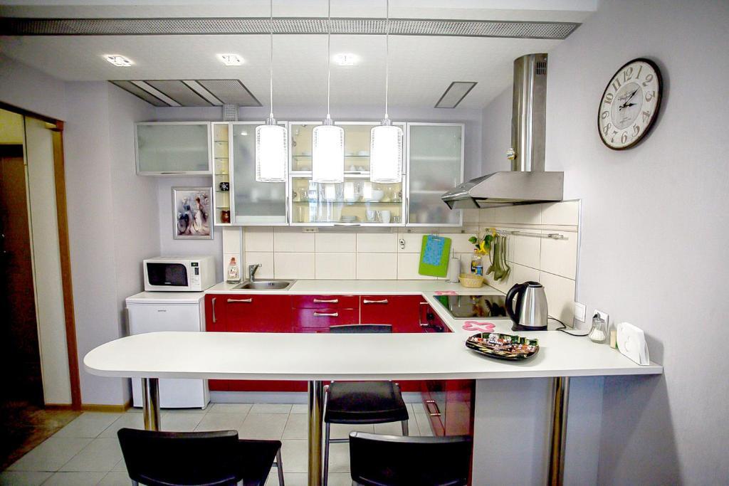 Кухня или мини-кухня в Апартаменты Позитив