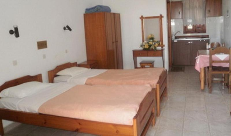 A bed or beds in a room at Princess Studios
