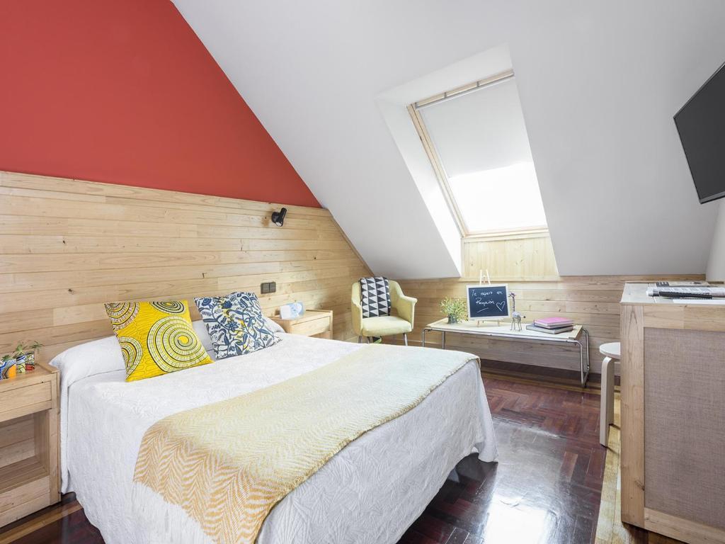 Cama o camas de una habitación en Hotel San Miguel