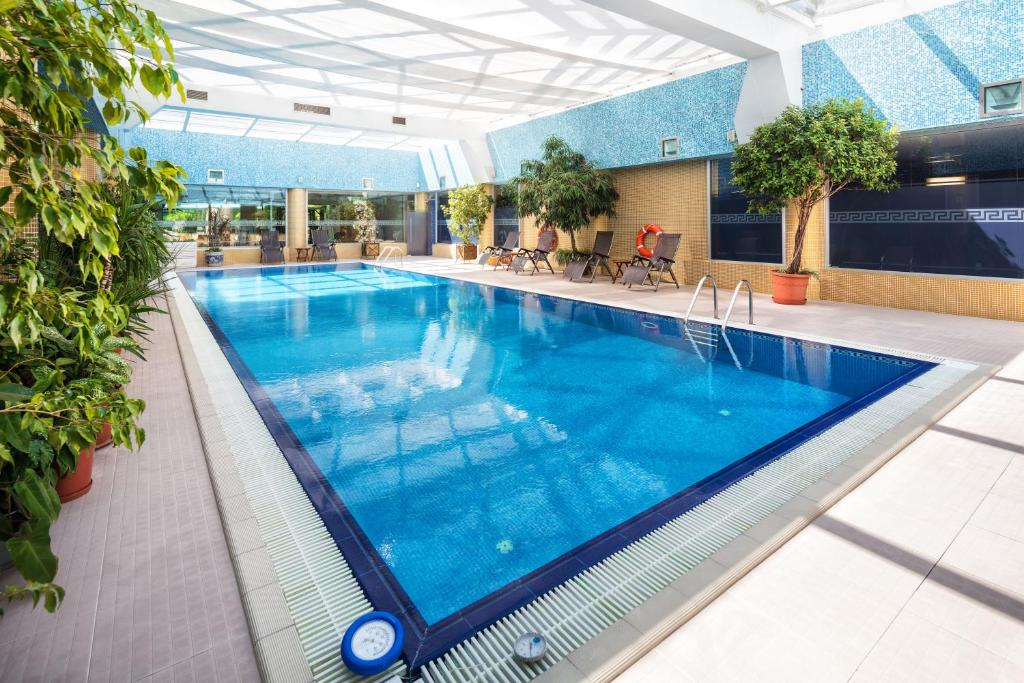 The swimming pool at or near The Dostyk Hotel