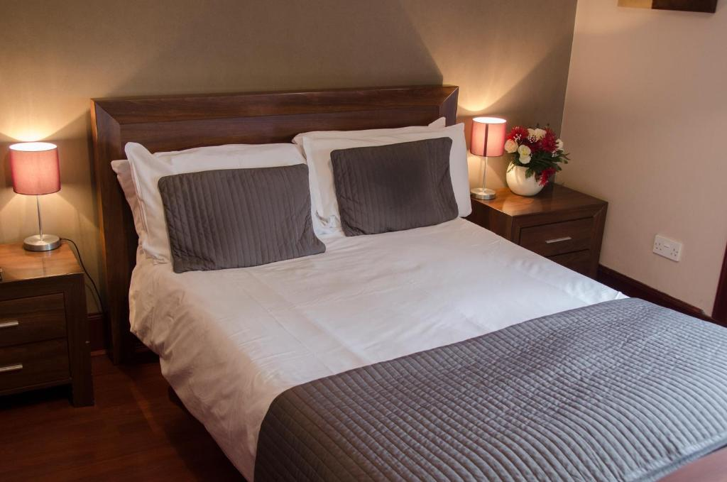 A bed or beds in a room at The Fullarton Park Hotel