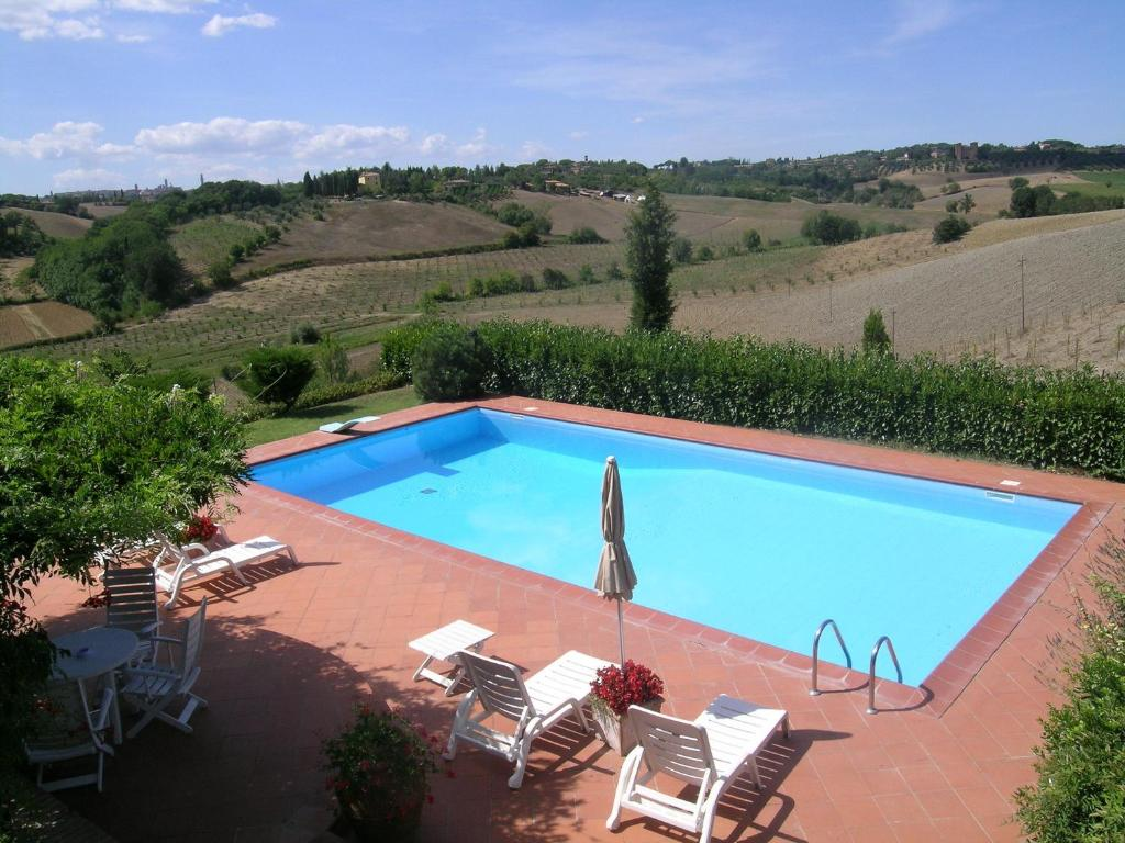 A view of the pool at Agriturismo Il Colle or nearby