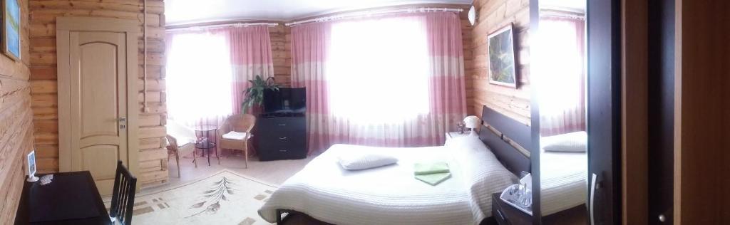 Кровать или кровати в номере Отель Березка