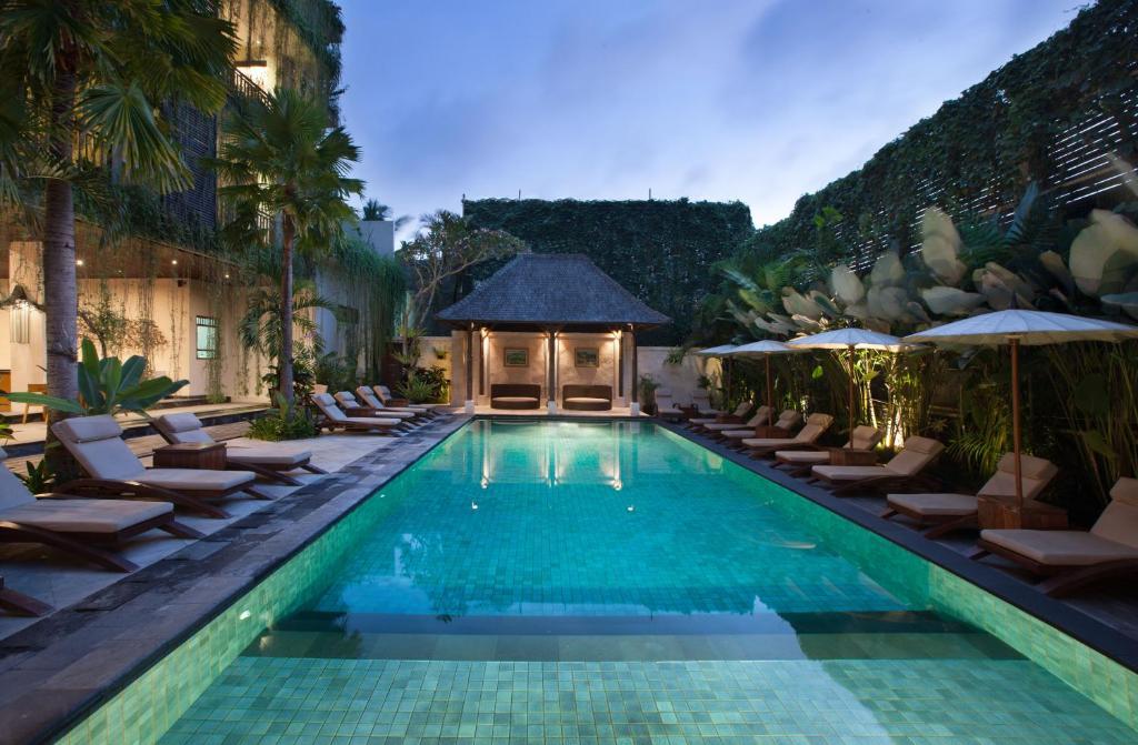 المسبح في فندق أوبود فيليدج أو بالجوار