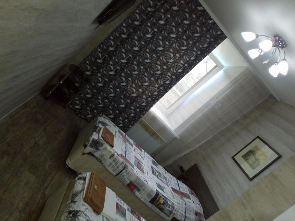 Кровать или кровати в номере Гостевой Дом на Советской