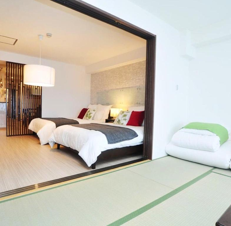 A bed or beds in a room at Sakura