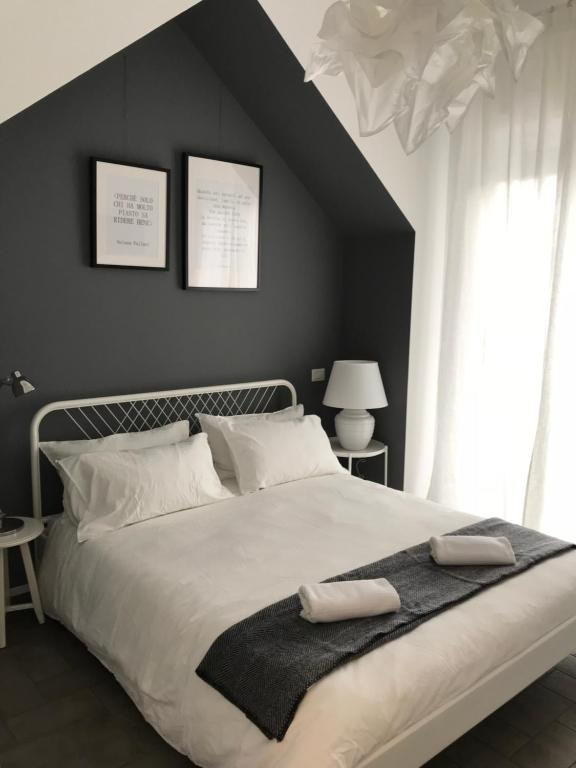 A bed or beds in a room at Salerno M'illumina