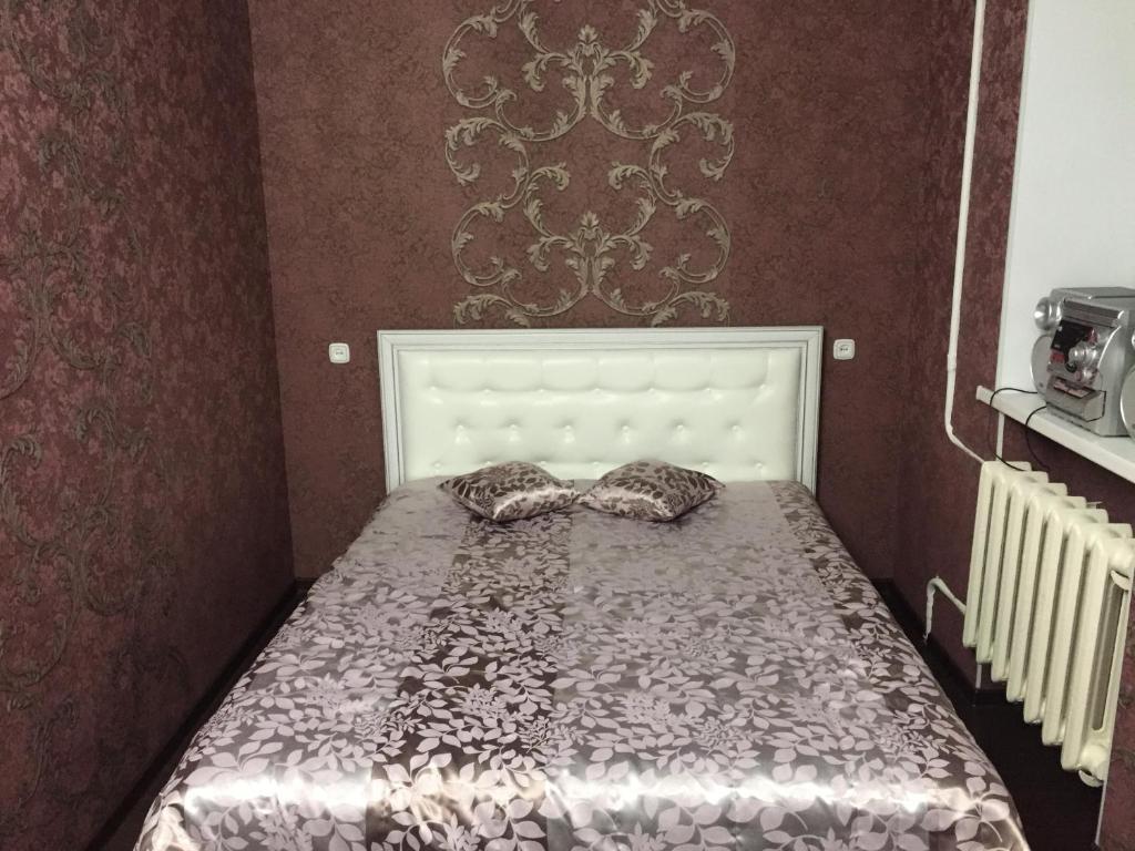 Кровать или кровати в номере Apartment on Truhanova
