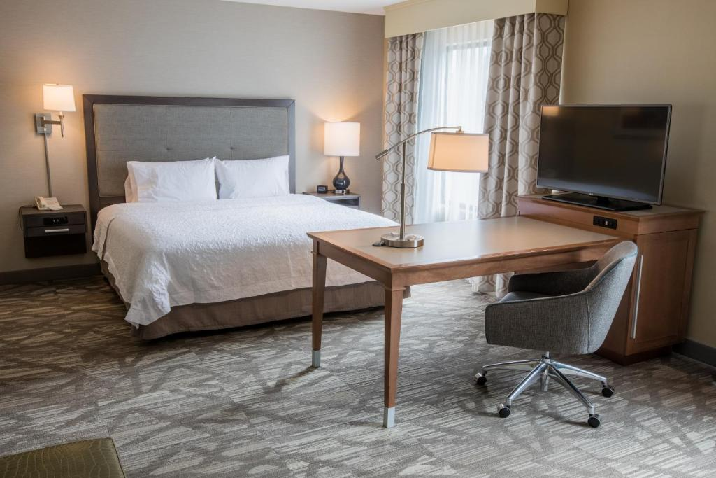 A bed or beds in a room at Hampton Inn & Suites Tilton